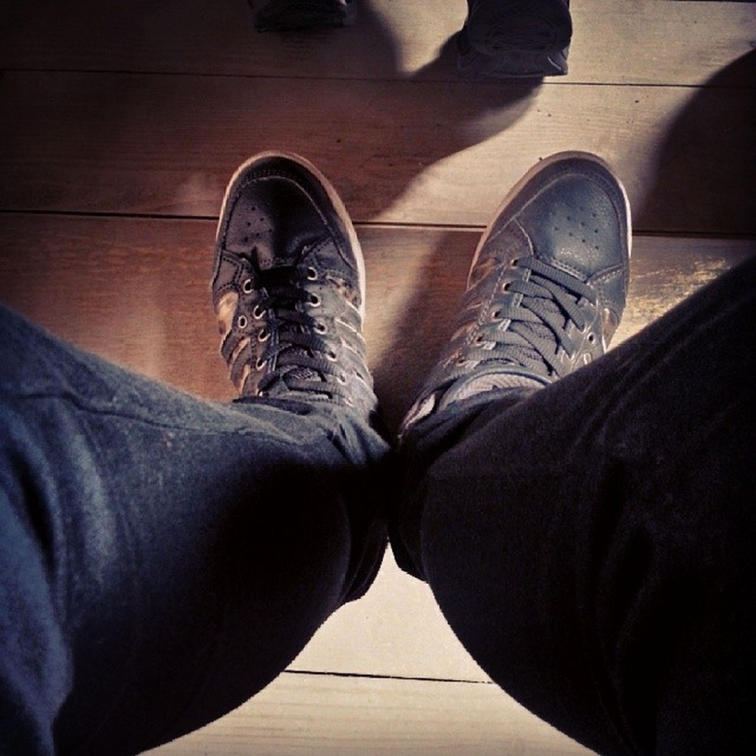 low section, person, shoe, jeans, personal perspective, footwear, human foot, lifestyles, standing, men, canvas shoe, leisure activity, indoors, high angle view, casual clothing, human limb, denim