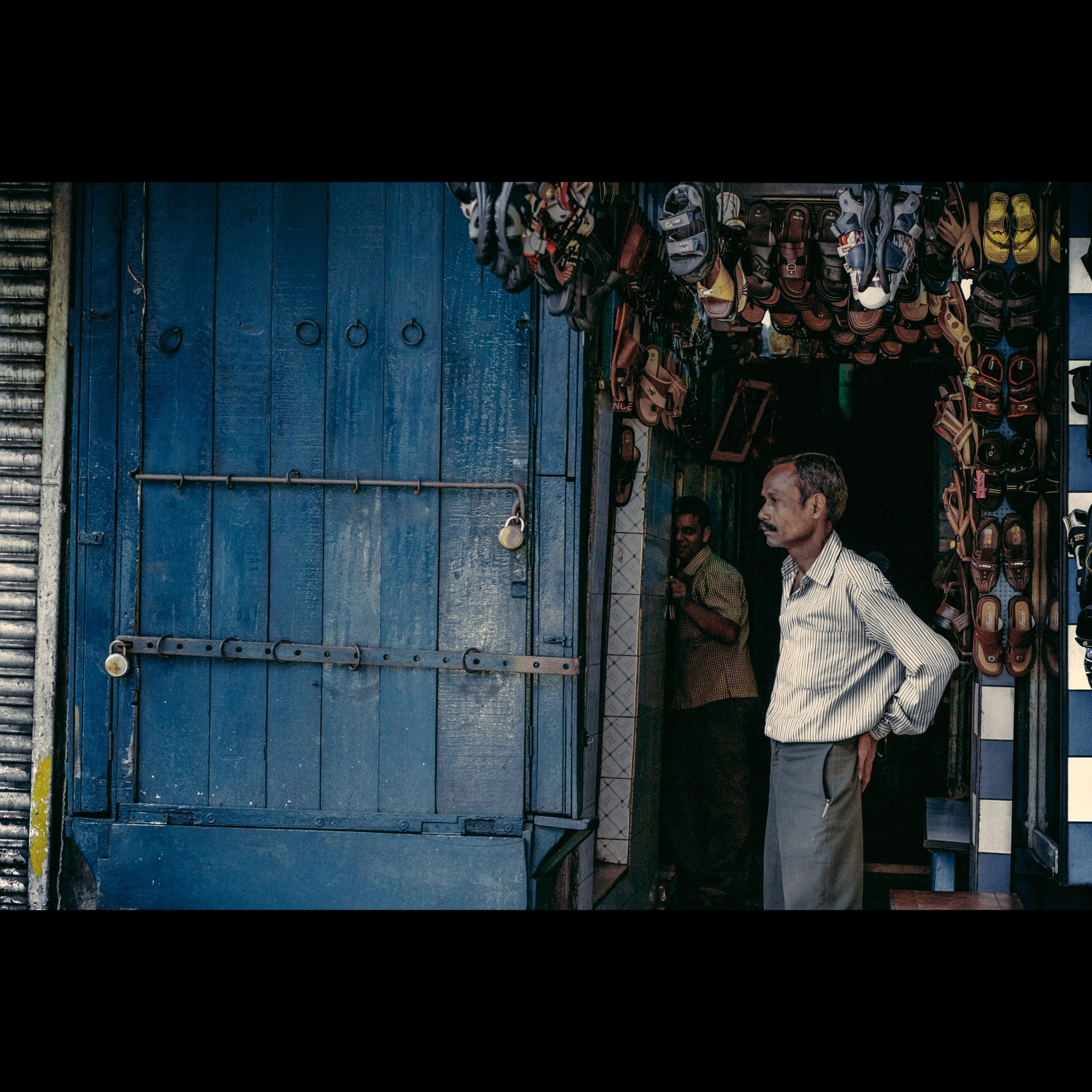 Streetphotography Shoemaker India Kolkata The Human Condition Man Streetvendor Portrait Blue Avigram First Eyeem Photo
