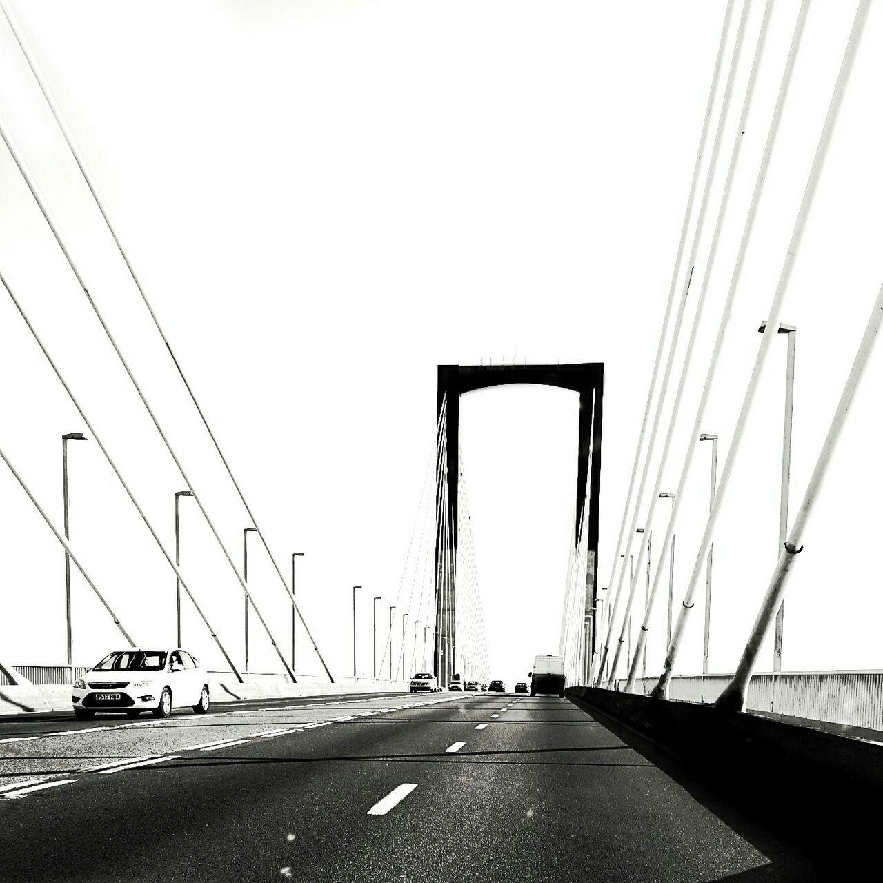 Cars On Bridge Against Clear Sky