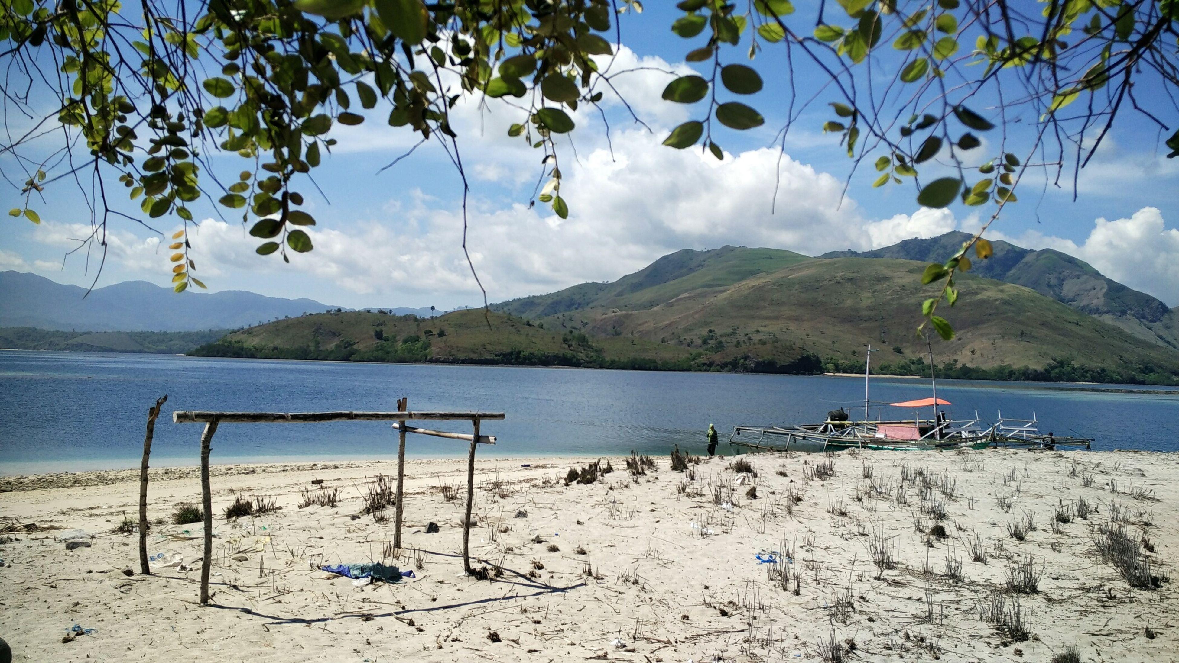 mountain, water, sky, mountain range, tranquility, tranquil scene, beach, scenics, beauty in nature, nature, sea, shore, cloud - sky, sand, cloud, lake, day, blue, idyllic, tree