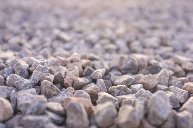 Pebbles. Pebbles Hard Backgrounds Texture Texture In Nature Close-up No People Outdoors Stone Material Stone And Pebbles Stones Depth Of Field Full Frame Grey Color Selective Focus
