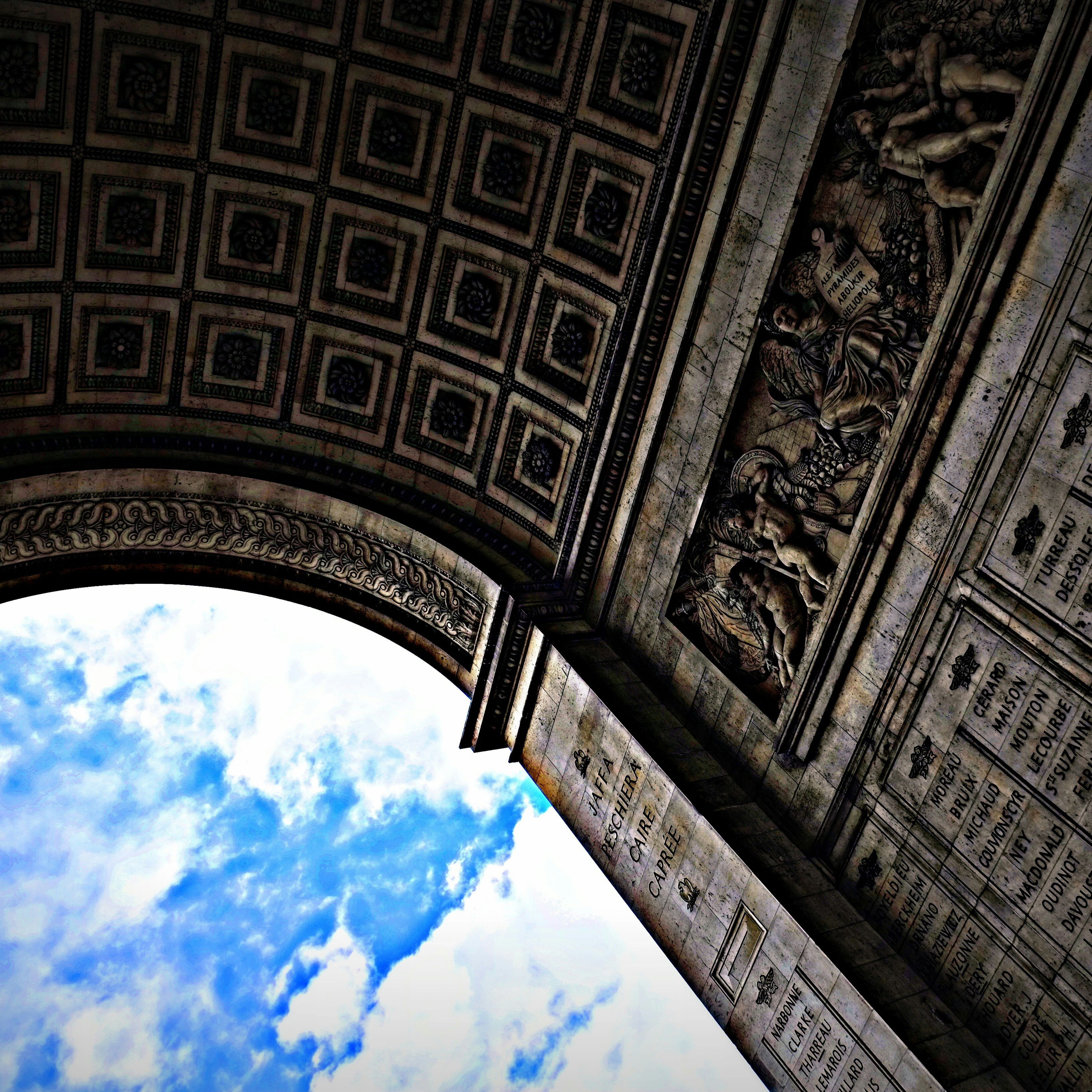 architecture, built structure, low angle view, famous place, history, travel destinations, international landmark, tourism, building exterior, sky, capital cities, arch, travel, architectural feature, cloud - sky, design, ornate, architectural column, art and craft, carving - craft product