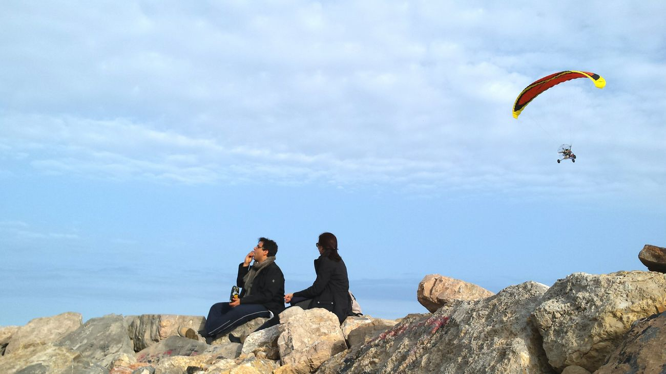 Flying Sky People Watching Mediterranean  Sea Vacations Travel EyeEm Best Shots Couple Enjoying Life Valencia, Spain Showcase April The KIOMI Collection Beach Photography Beach Life Clouds And Sky Sky And Clouds