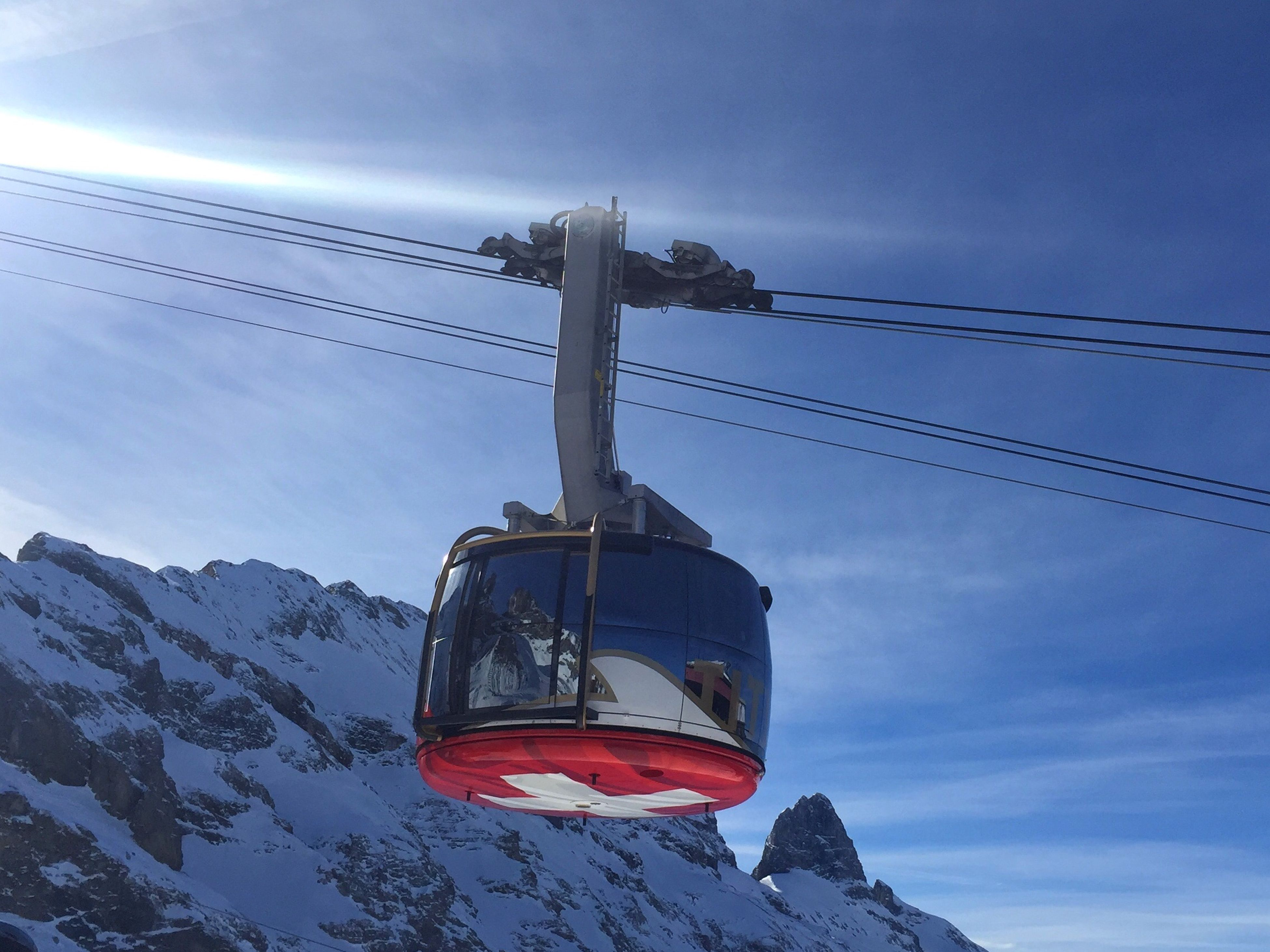 Titlis Rotair Cable Car Cable Car Blue Blue Sky Alps Alps Switzerland Reflection Mountain Mountains Engelberg Titlis Titlis,Switzerland Titlisrotair Rotair Rotating Cable Car Mountain Reflection Cable Swiss Flag Swiss Tourism Ski Holiday Winter Holiday Snow Sun
