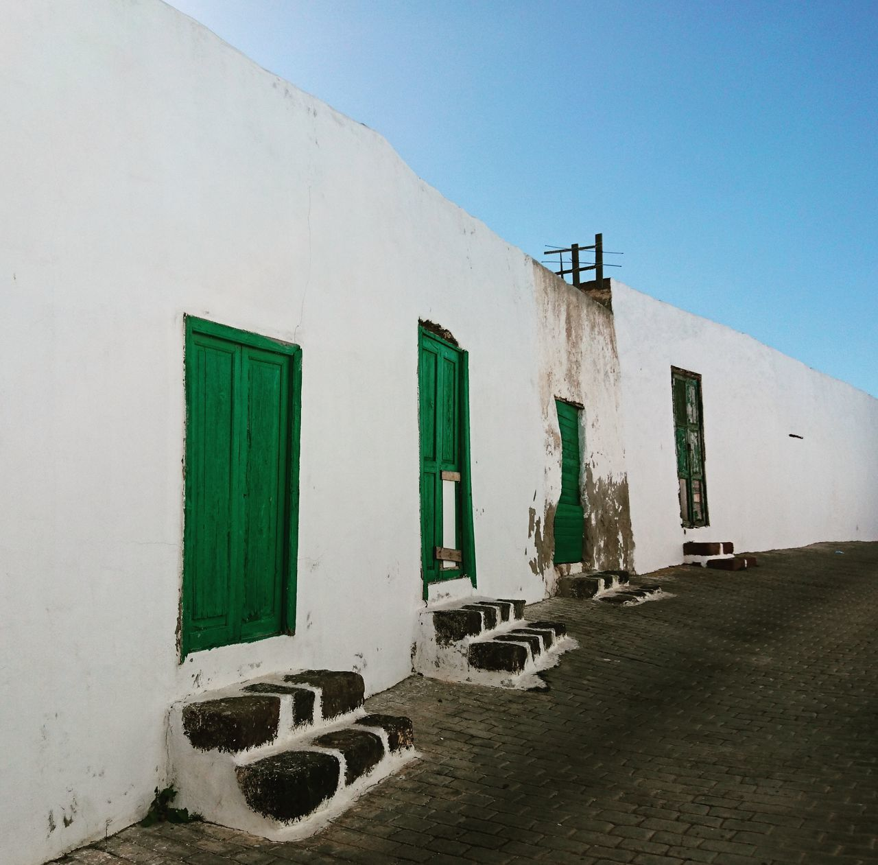 Building Exterior Architecture Green Color Outdoors Sky Lanzarote-Canarias Teguise White Wall White City Green Doors Scenics Wall Old Buildings Architecture