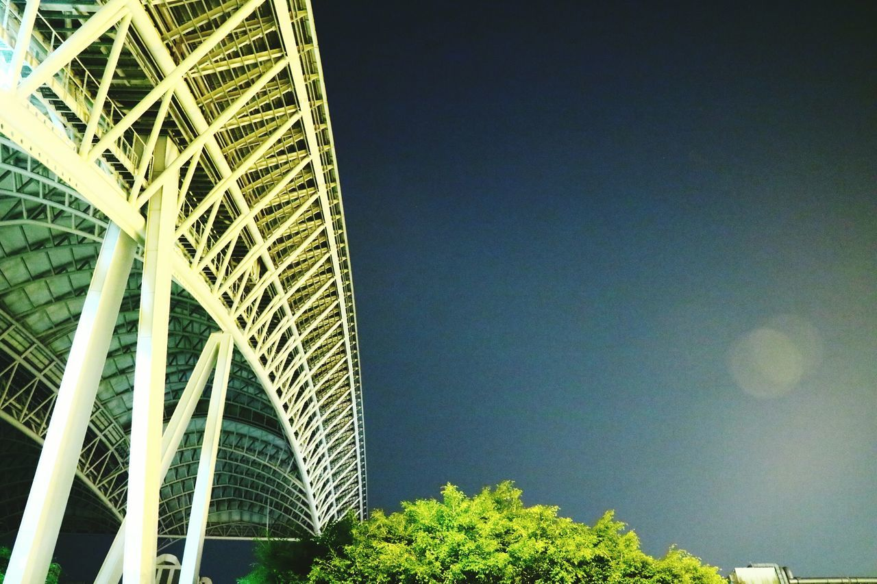 architecture, built structure, low angle view, modern, no people, building exterior, clear sky, outdoors, skyscraper, day, city, tree, sky, nature