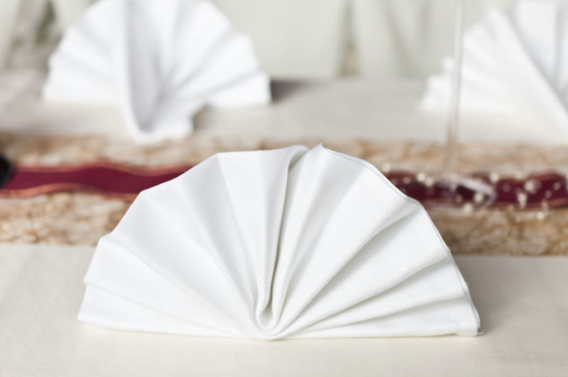 Banquet Event Food And Drink NapkinFolding Wedding Banket Close-up Day Focus On Foreground Food Food And Drink Freshness Gourmet Indoors  Napkin Ready-to-eat Real People Restaurant Round Serviette Table Table Decoration Table Napkins Tablecloth