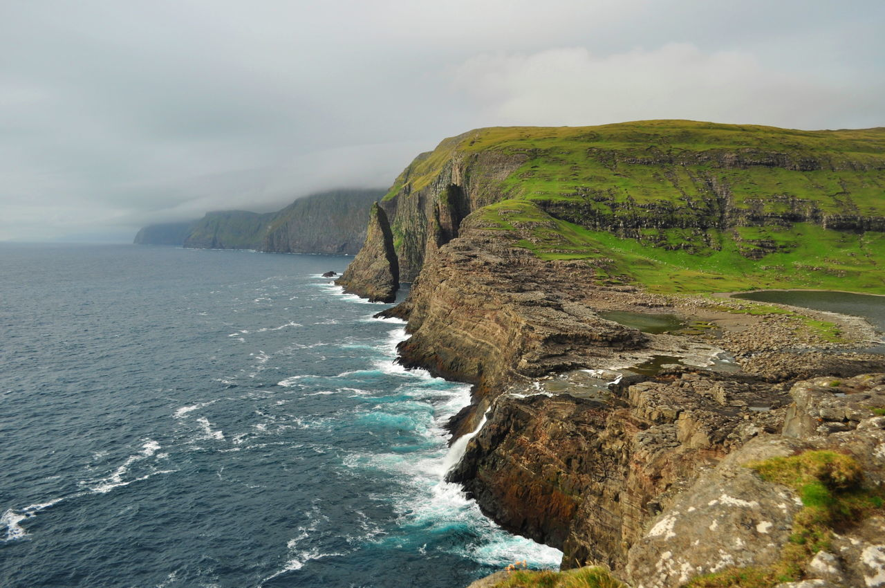Cliff Coastline Faroe Islands Mountain Nature Rock - Object Rock Formation Sea Travel Destinations Vacations Water Waterfall Waterfront Wave