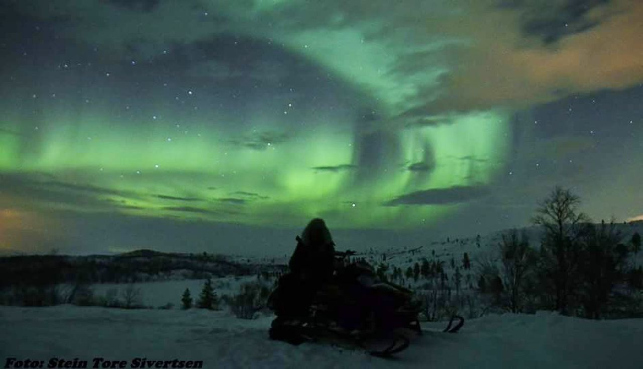 winter, weather, nature, cold temperature, snow, beauty in nature, sky, night, outdoors, sitting, star - space, tranquility, scenics, one person, aurora polaris, real people, one woman only, astronomy, people