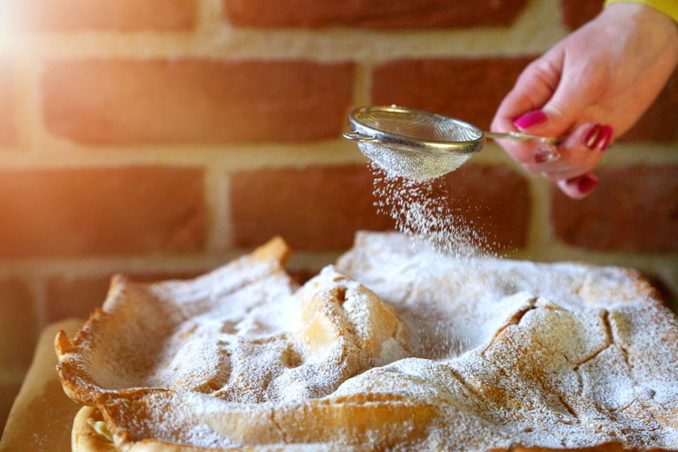 Sprinkle powdered sugar on cake Baking Cake Close-up Cooking Day Food Food And Drink Freshness Healthy Eating Human Body Part Human Hand Indoors  Motion Occupation One Person Powdered Sugar Preparation  Preparing Food Real People Sprinkle Unrecognizable Person