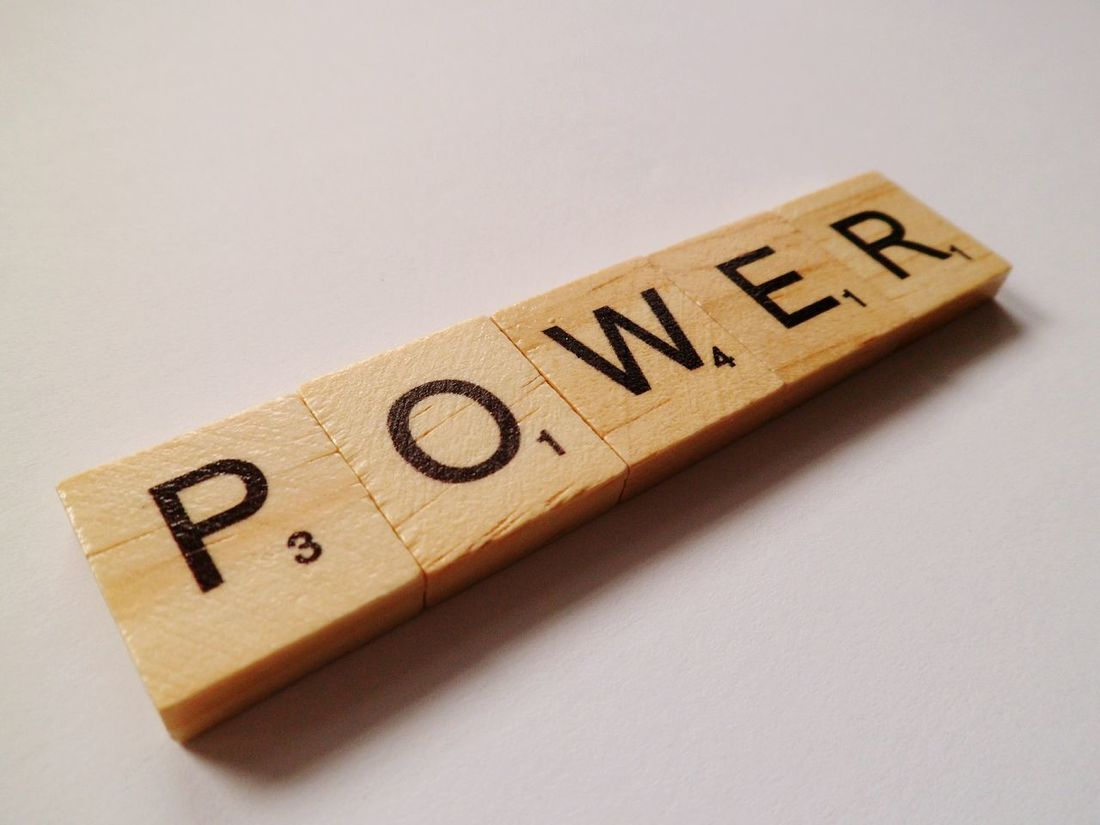 Power Focus On Foreground No People Still Life Slanted Wood - Material Simplicity Hello World Power Quote Letters Leisure Games Creativity The Alphabet Leisure Activity Text Indoors  Plain Background White Background Word Game Communication Studio Shot Western Script Close-up Capital Letter Low Angle View