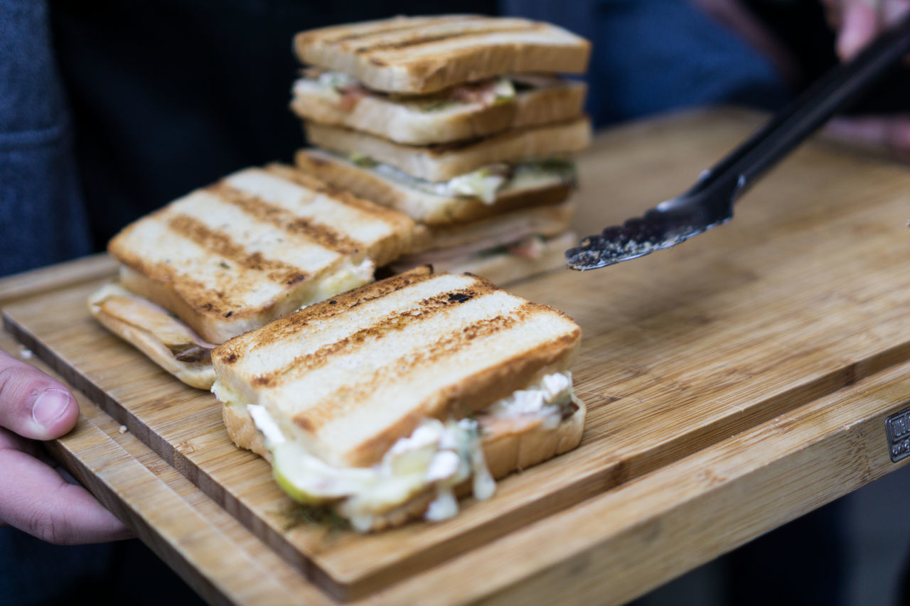 Barbeque Sandwich Barbecue Bread Close-up Cutting Board Day Food Food And Drink Food Stories Freshness Healthy Eating Holding Human Body Part Human Hand Indoors  One Person People Ready-to-eat Real People Sandwich Table