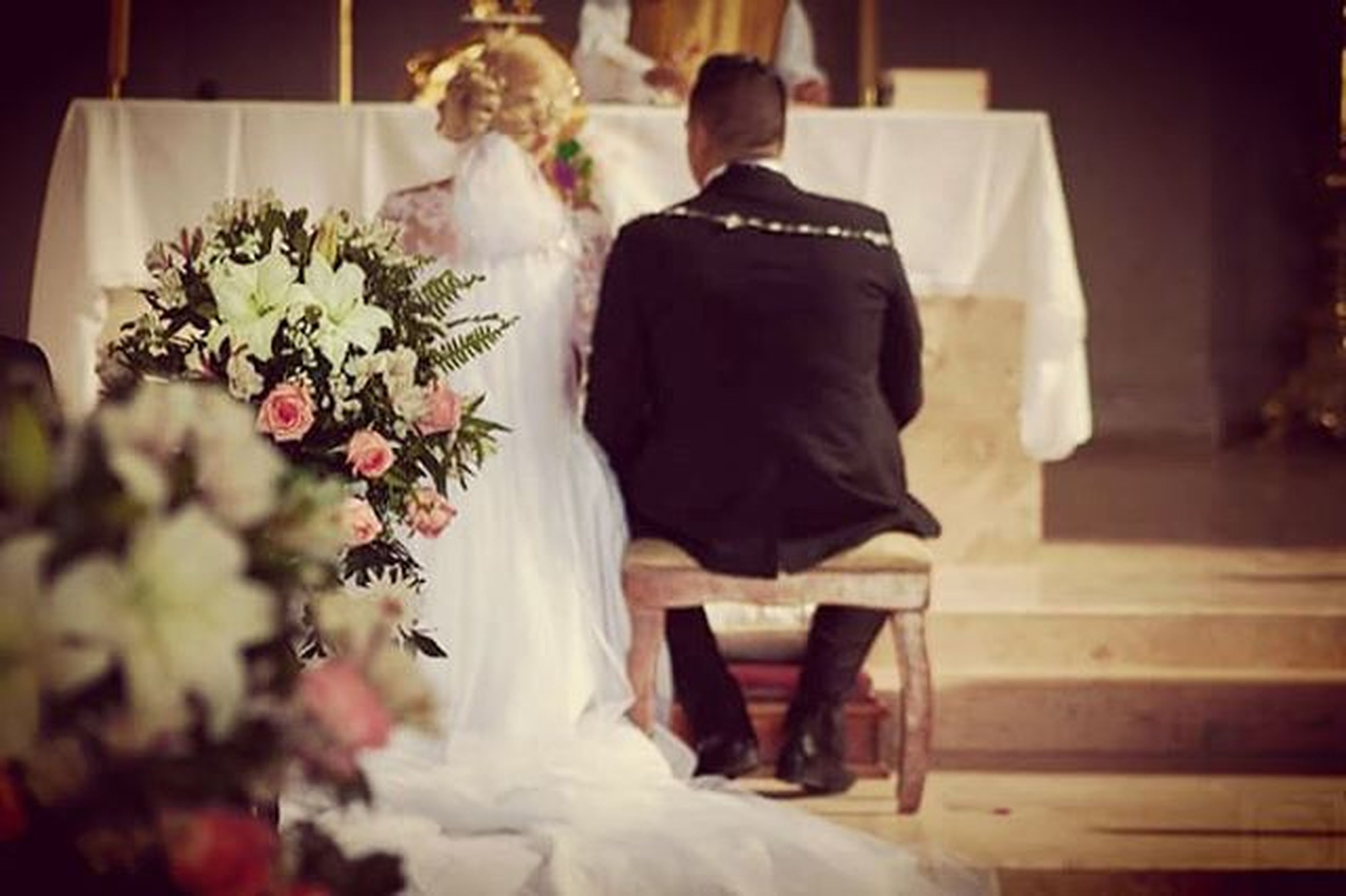 indoors, flower, rear view, person, lifestyles, standing, casual clothing, home interior, sitting, freshness, focus on foreground, table, men, full length, leisure activity, religion, celebration, bouquet