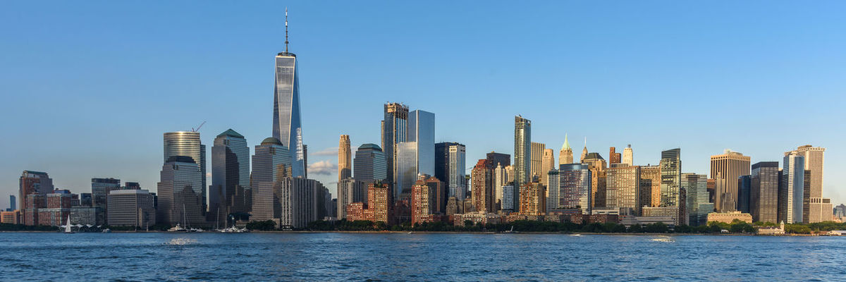 Manhattan New York City USA Architecture Blue Building Exterior Built Structure City Cityscape Development Downtown District Financial District  Modern No People Outdoors River Skyline Skyscraper Tall Tall - High Tower Travel Destinations Urban Skyline Water Waterfront