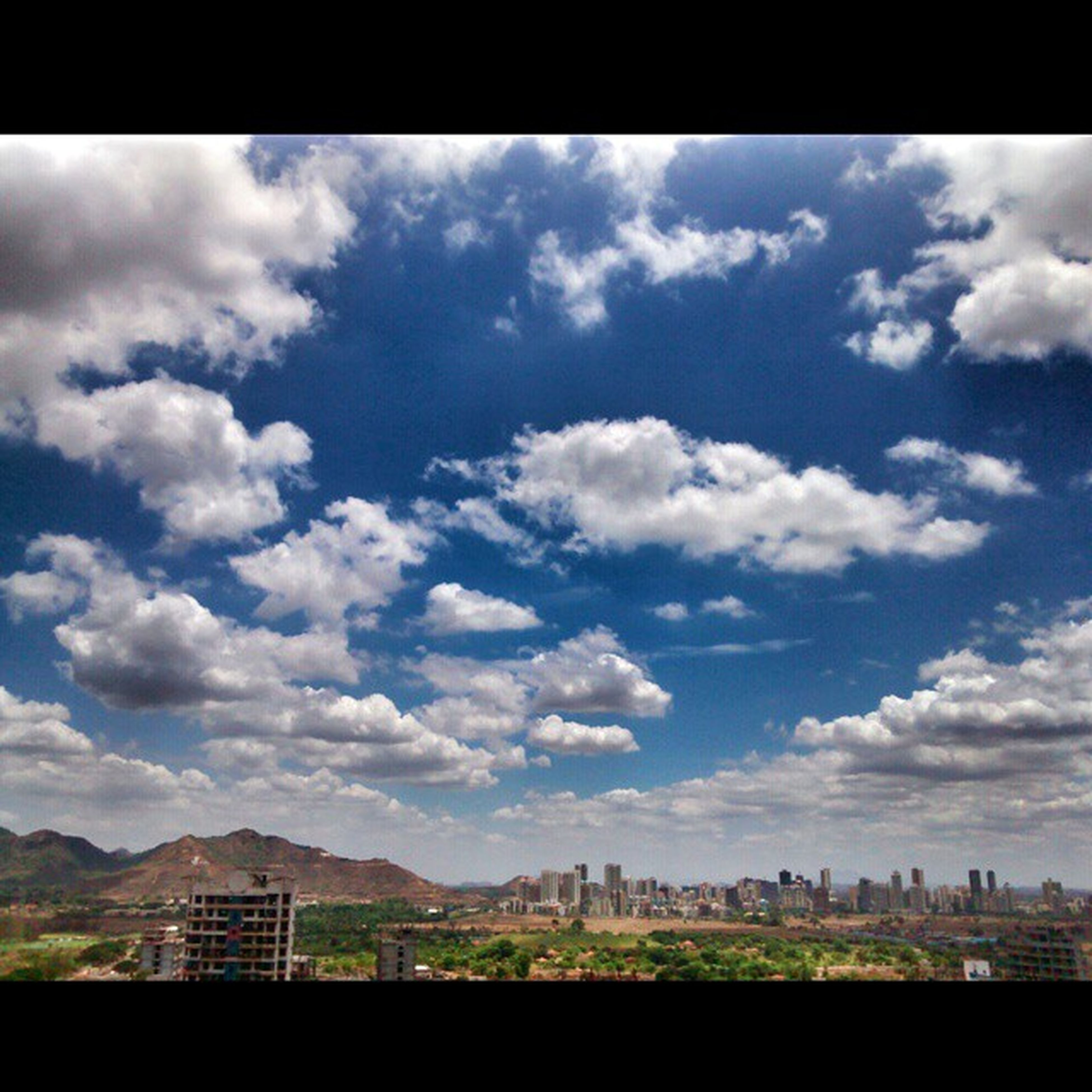 sky, architecture, building exterior, built structure, transfer print, cloud - sky, cloud, city, cloudy, cityscape, auto post production filter, day, mountain, landscape, outdoors, nature, residential building, no people, residential structure, residential district