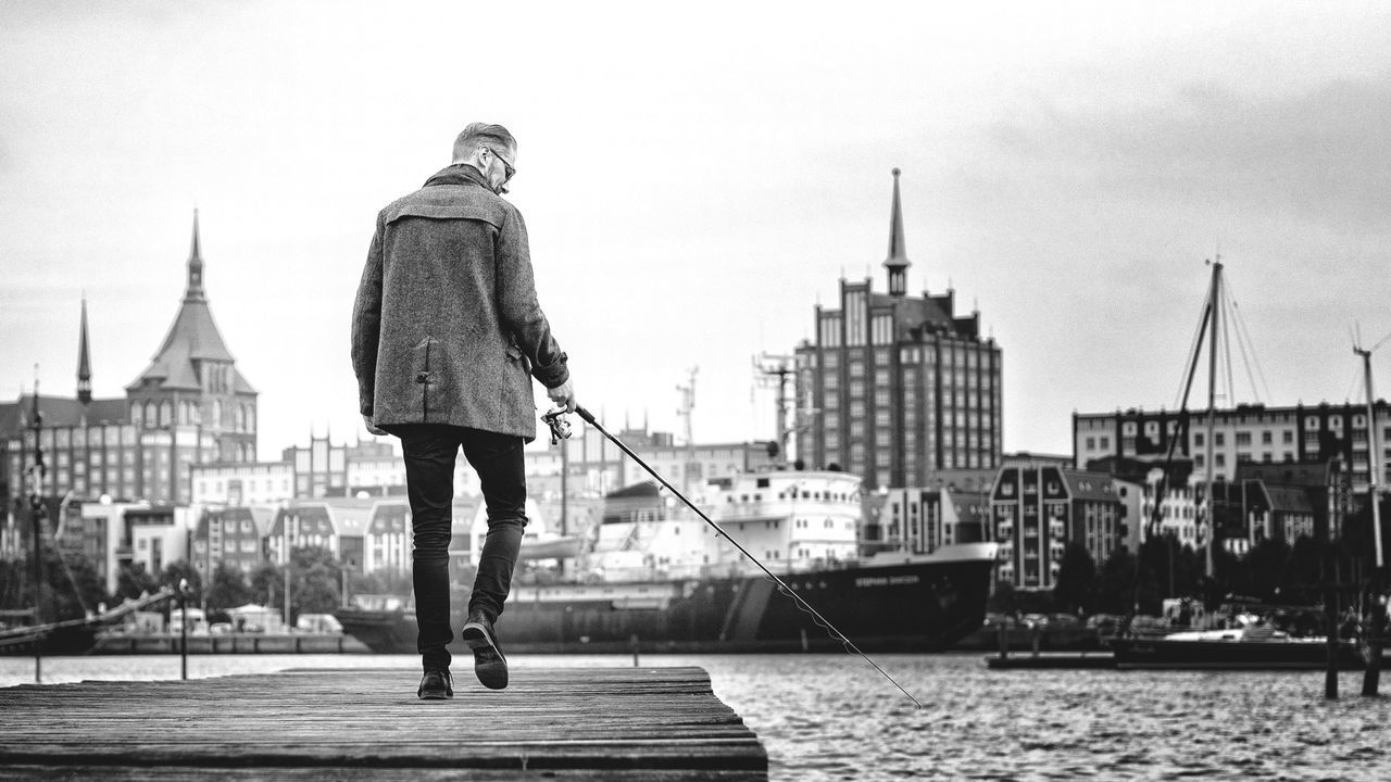 Fishing One Hand Cool Walking Landing Stage Jetty Germany Hafen Harbour Fishing Rod Fishing Pole Walk Men Easy Coolness Blackandwhite Monochrome Blancoynegro The Street Photographer - 2016 EyeEm Awards People Of The Oceans