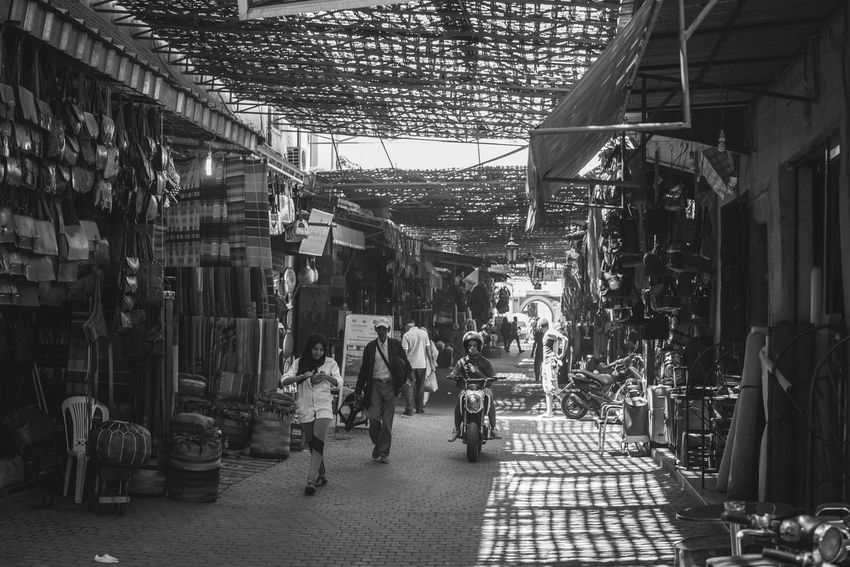 Architecture Blackandwhite Building Exterior Built Structure Buying Casual Clothing Day Full Length Leisure Activity Lifestyles Market Marrakech Medium Group Of People Men Morroco Outdoors Souk Souks Street Street Market The Way Forward Travelling Walking Monochrome Photography