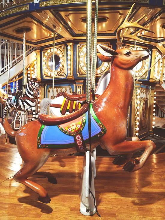 England, UK London Antlers Pretty Winter Wonderland Fairground Attractions Amusement Park Rides Fairground Fun Multi Colored Horse Magic Illuminated Circus Fairground Amusement Park At Night Festive Season Lights Christmas Outdoors Stag Deer Carouselle