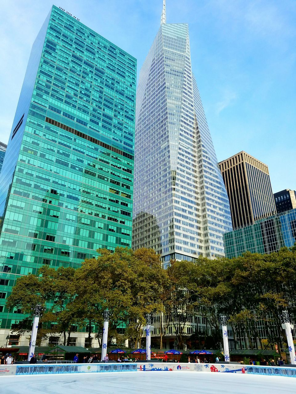 architecture, skyscraper, modern, building exterior, built structure, city, sky, low angle view, city life, tree, outdoors, travel destinations, day, downtown district, no people, cityscape