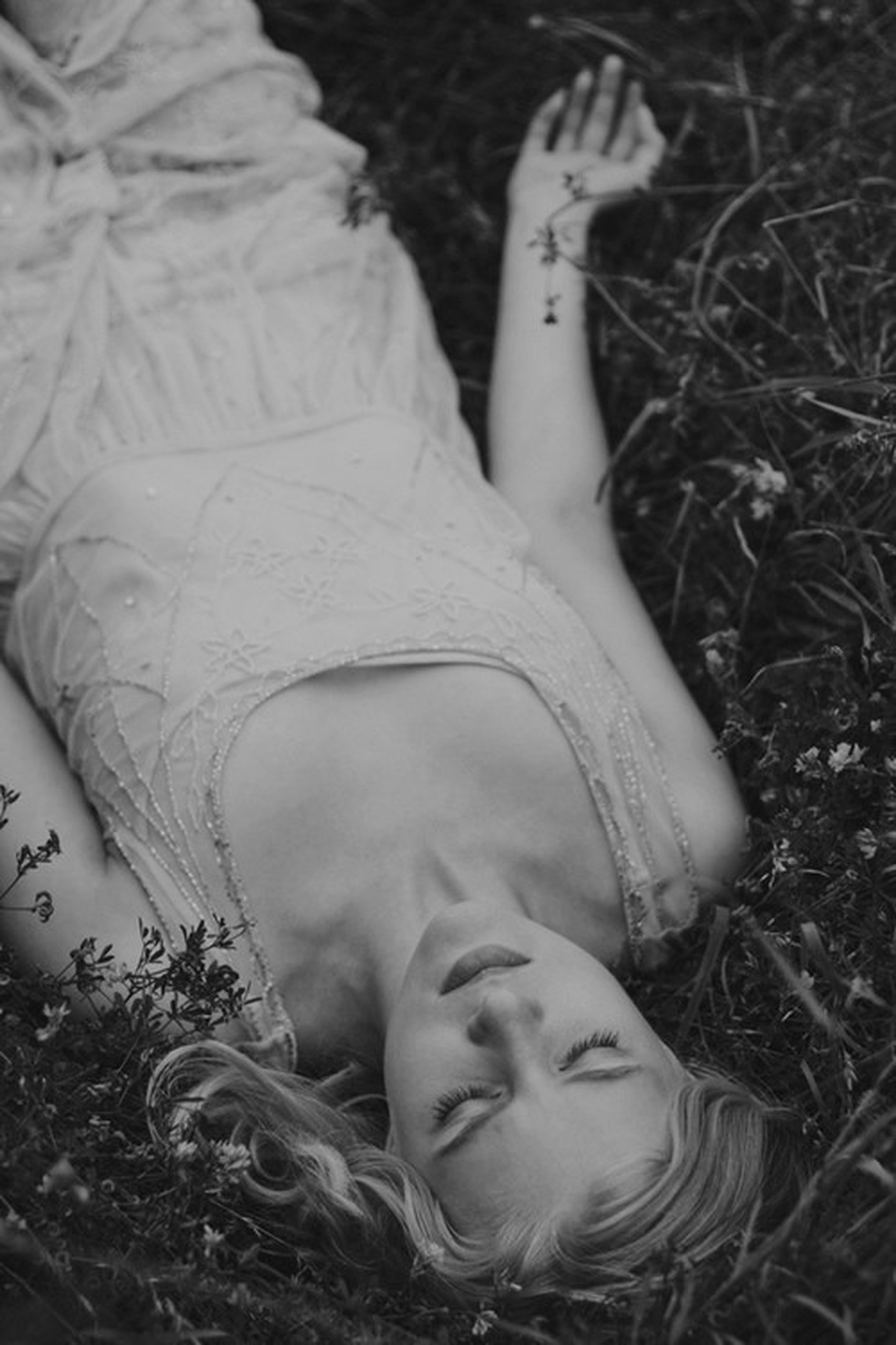 lifestyles, leisure activity, person, relaxation, lying down, childhood, high angle view, young adult, young women, casual clothing, grass, innocence, elementary age, girls, eyes closed, lying on back, resting, cute