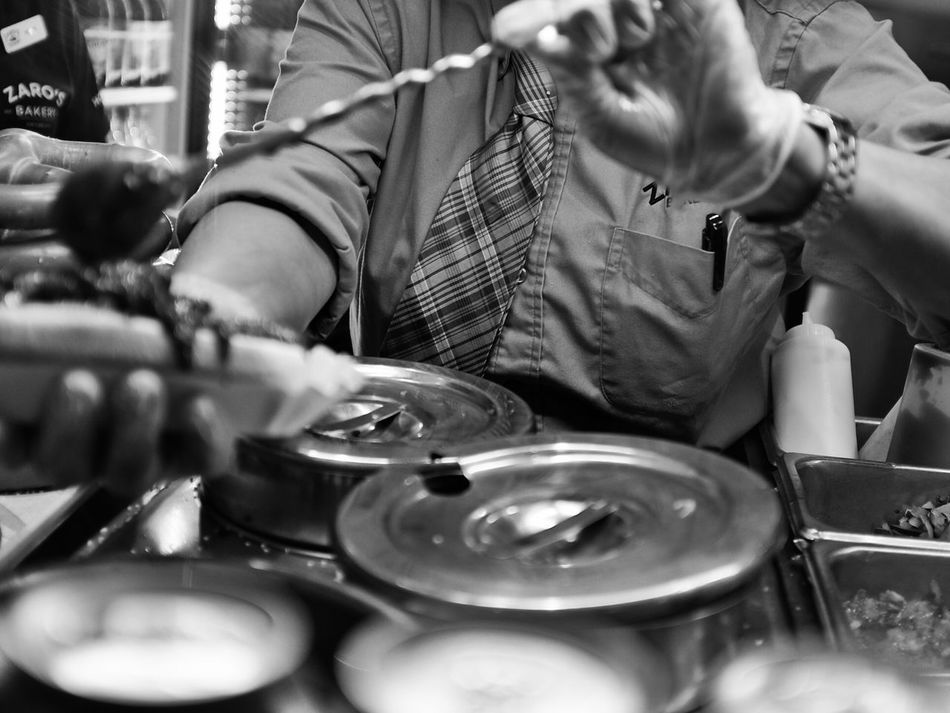 Making the famous American hotdog with everything in Grand Central Terminal, New York. USA New York Grand Central Terminal Zaro's Bakery Food HotDog Restaurant Train Station Street Photography X100t Fujifilm Up Close Street Photography Black And White Monochrome Photography