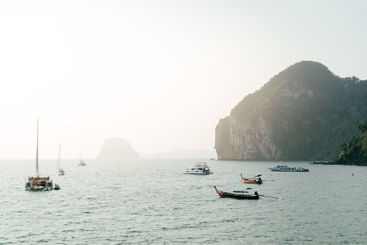Thailand Nautical Vessel Travel Destinations Rock - Object Transportation Cliff Water Tranquil Scene Outdoors Mountain Beauty In Nature Sunset Sunset_collection Travel Traveling