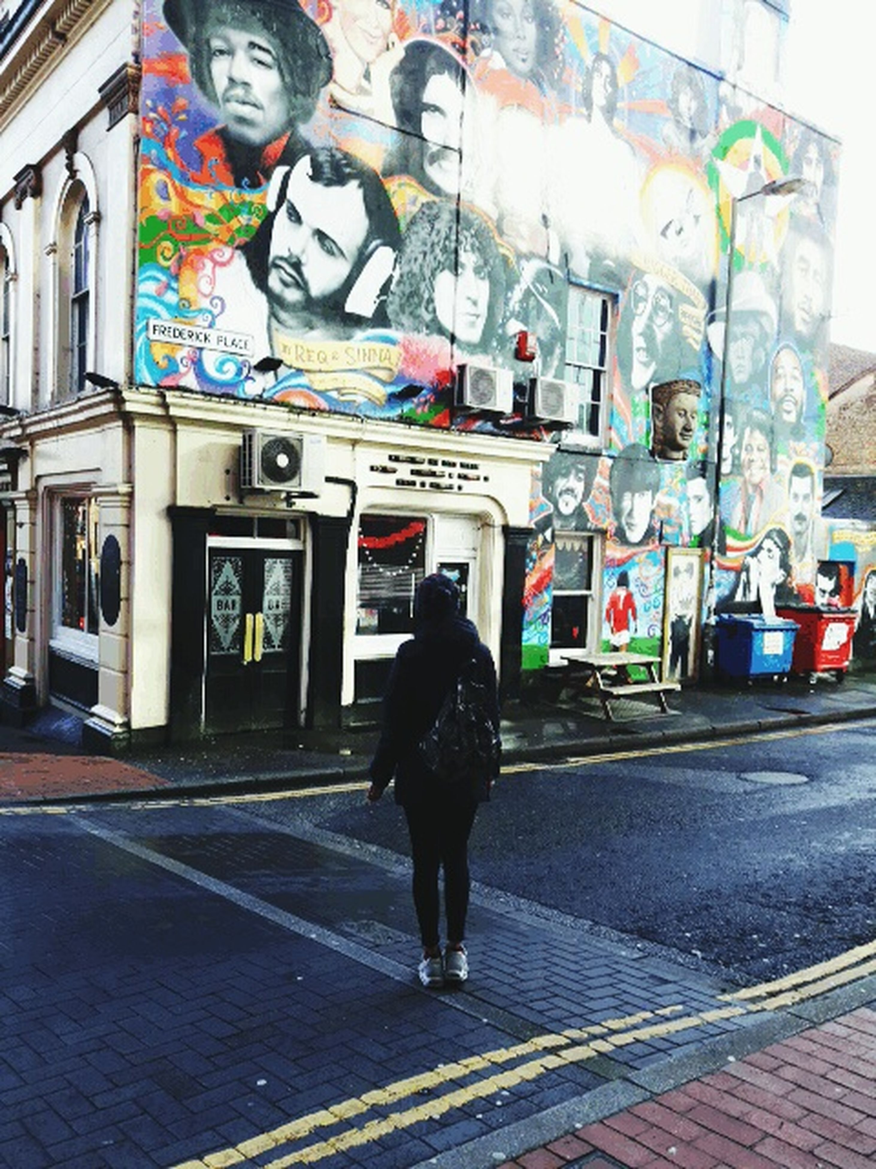 full length, lifestyles, architecture, building exterior, built structure, casual clothing, graffiti, rear view, standing, walking, street, men, leisure activity, person, city, front view, day, sidewalk