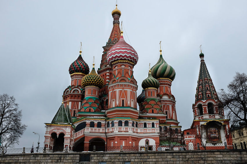 Low angle view looking up at St Basil's Cathedral in Moscow Moscow St Basil's Cathedral Architecture Building Exterior Built Structure City Day Dome History Low Angle View No People Outdoors Place Of Worship Religion Sky Spirituality Travel Destinations
