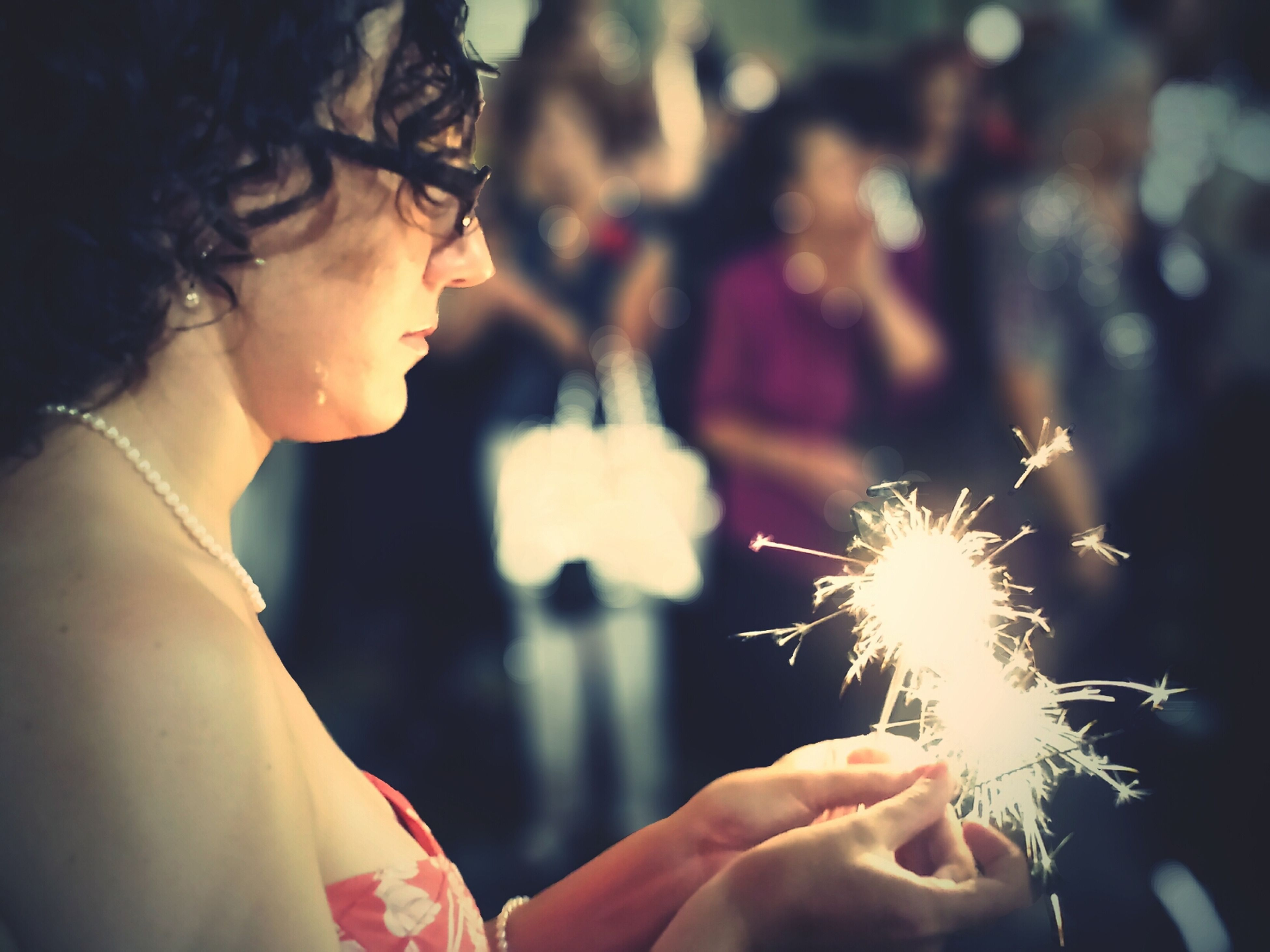 person, holding, lifestyles, part of, celebration, leisure activity, focus on foreground, arts culture and entertainment, illuminated, night, cropped, fire - natural phenomenon, event, burning, men, close-up