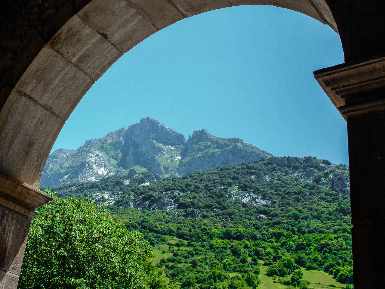 arch, mountain, architecture, day, no people, nature, mountain range, built structure, outdoors, beauty in nature, tree, sky