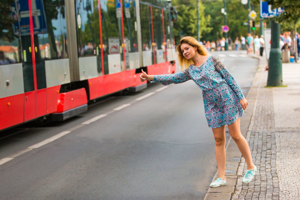 real people, one person, full length, leisure activity, lifestyles, outdoors, focus on foreground, casual clothing, transportation, day, young women, young adult, people