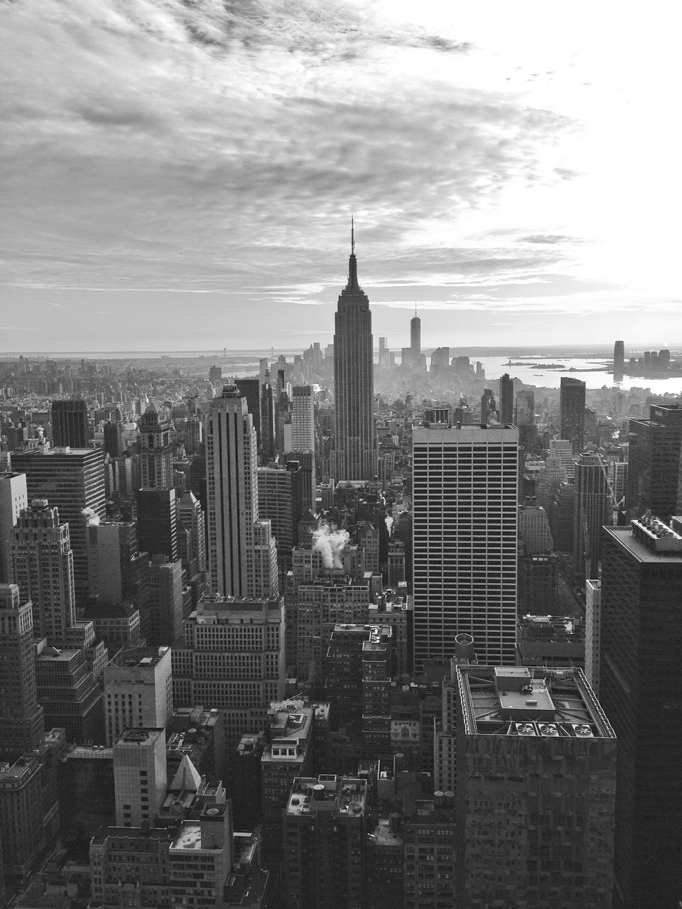 Empire State Building And Cityscape Against Sky