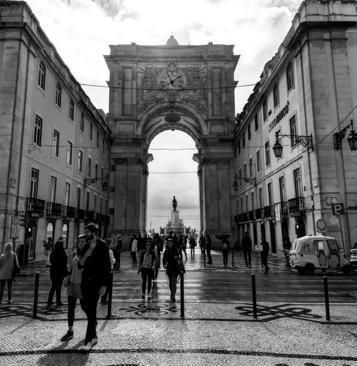 Arco do triunfo da Rua Augusta. Architecture Triumphal Arch Arch Built Structure History Travel Destinations Outdoors City People Black And White in Lisbon - Portugal Black And White Friday