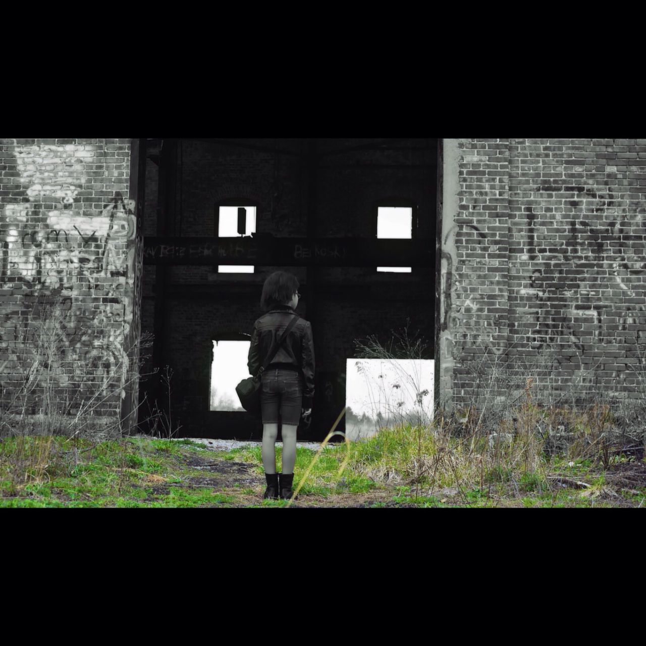 Full Length Rear View Of Boy Standing Against Abandoned Building