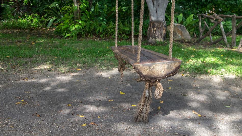Wood swing seat in the garden. Day Garden Nature No People Outdoors Swing Swinging Wood Swing Wood Swing Seat