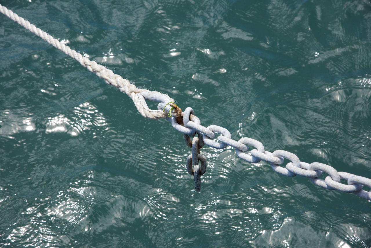Closeup of nautical knot and chainlink connected over the Indian Ocean waters in Western Australia. Attached Beauty In Nature Chain Chainlink Closeup Connected Connection Day Diagonal Full Frame High Angle View Hooked Indian Ocean Knot Loop Nature Nautical Nautical Theme Ocean Outdoors Rope Sea Water Western Australia White