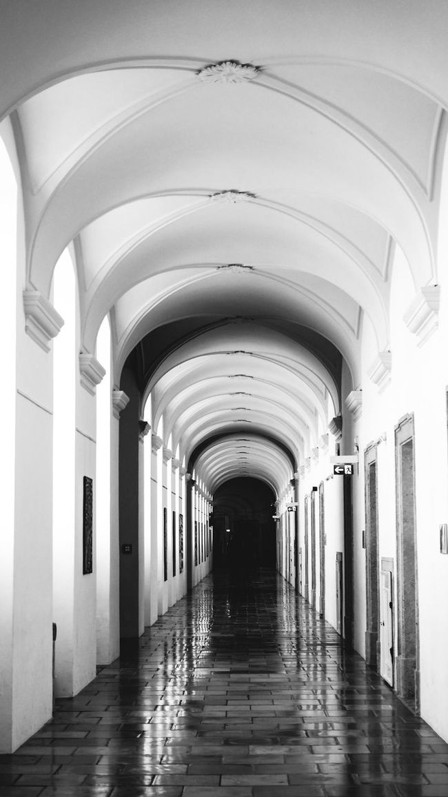 Arch Arched Architectural Feature Architecture Archway Black & White Black And White Bradley Olson Bradleywarren Photography Built Structure Ceiling Ceiling Light  Corridor Day Diminishing Perspective Empty Flooring In A Row Long Monochrome Narrow Pedestrian Walkway Monochrome Photography The Way Forward Vanishing Point
