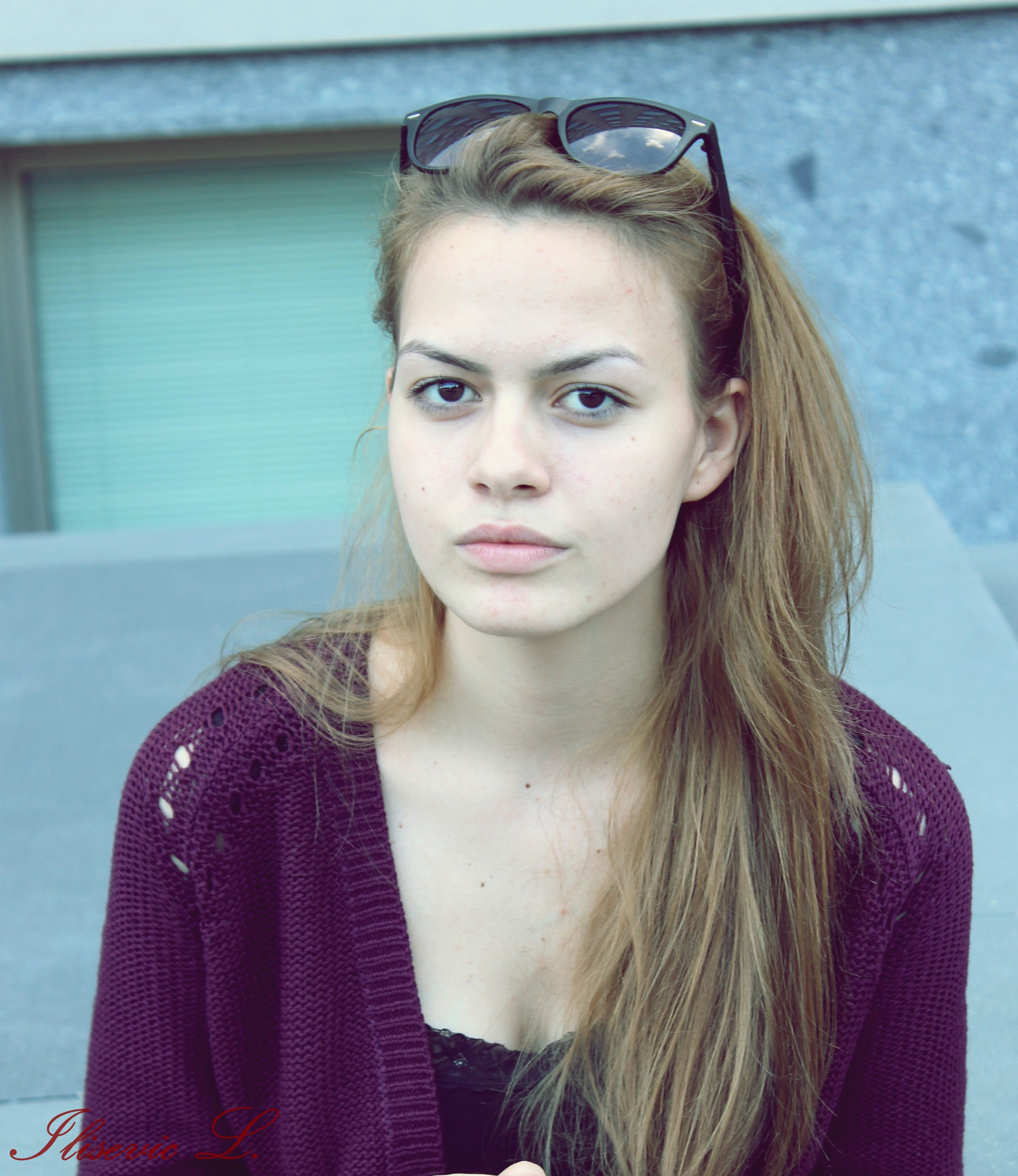 portrait, looking at camera, person, young adult, headshot, front view, young women, lifestyles, long hair, close-up, leisure activity, smiling, head and shoulders, casual clothing, indoors, focus on foreground