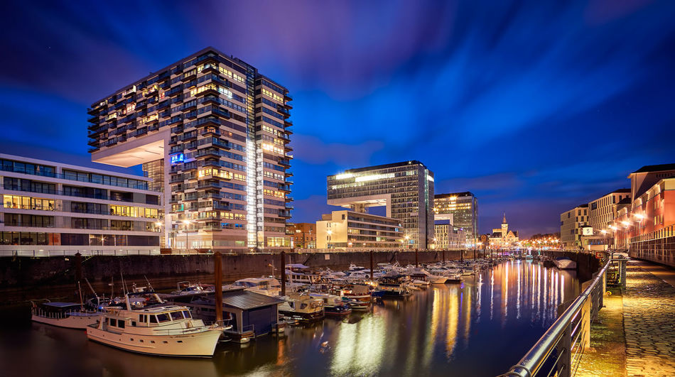 Rheinauhafen is a must see spot at night. The Architecture on this place, complemented with the lights, make it a really awesome place to visit at night. To see more, check www.behintheobjective.com The photo is available on the eyeem Market, in case you want to buy it! Architecture Building Building Exterior Built Structure City City Life Cityscape Cologne Connection Crowded Engineering Famous Place International Landmark Modern Night Office Building Outdoors Residential District Residential Structure Rheinauhafen Skyscraper Tower Cities At Night Fine Art Photography