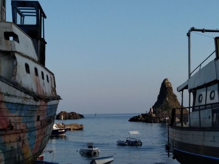 Acitrezza harbor with Faraglioni. Near Catania, Sicily Nautical Vessel Water Architecture Sea No People Outdoors Building Exterior Day Clear Sky City Sky Travel Destinations Beauty In Nature Scenics Tranquility Acitrezza  Harbor Catania Sicily The Week On EyeEm