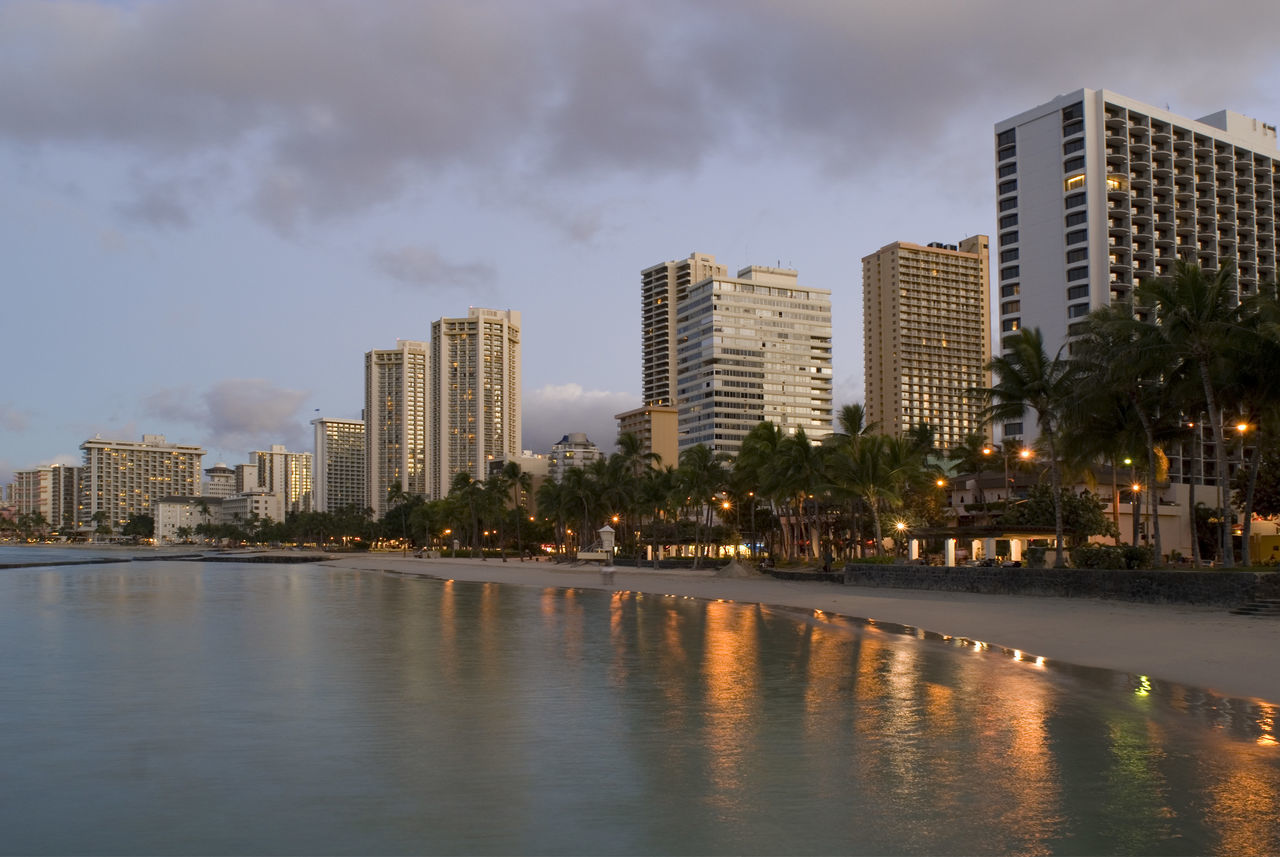 Sunrise over the resort hotels blocks at Waikiki beach, Honolulu, Hawaii. Building Exterior Dawn Day Break Daybreak Honolulu  Hotels Lights Modern Postcard View Reflection Reflection Reflectionlights Reflections Sand Sands Sunrise Tall - High Trees Urban Skyline Waikiki Beach Water