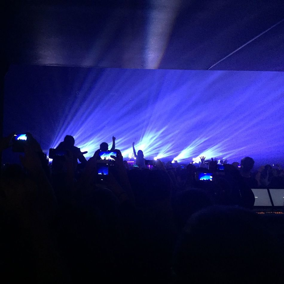 Large Group Of People Crowd Arts Culture And Entertainment Music Performance Audience Excitement Enjoyment Real People Popular Music Concert Event Stage Light Fun Silhouette Togetherness Women Leisure Activity Nightlife Illuminated Stage - Performance Space