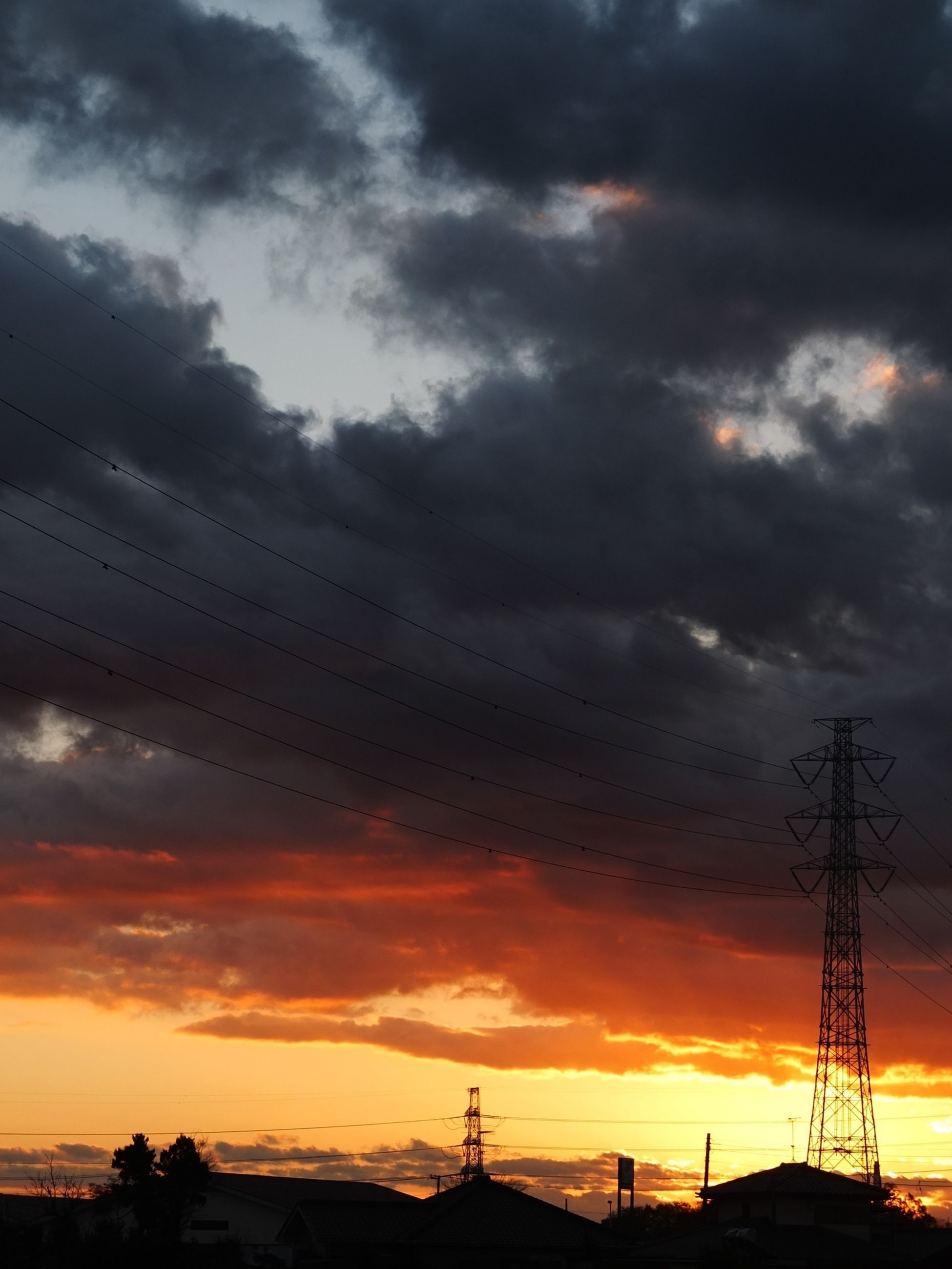 sunset, sky, cloud - sky, silhouette, cloudy, low angle view, beauty in nature, orange color, scenics, power line, weather, cloud, nature, bird, dramatic sky, connection, tranquility, overcast, tranquil scene, electricity pylon