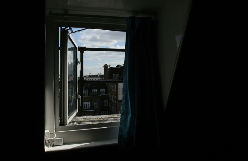LONDON/UK-09, 2007: Attic opened window with a view to one of Paddington' buildings. Attic London Paddington Architecture Built Structure Curtain Day Open Door Window Postcode Postcards