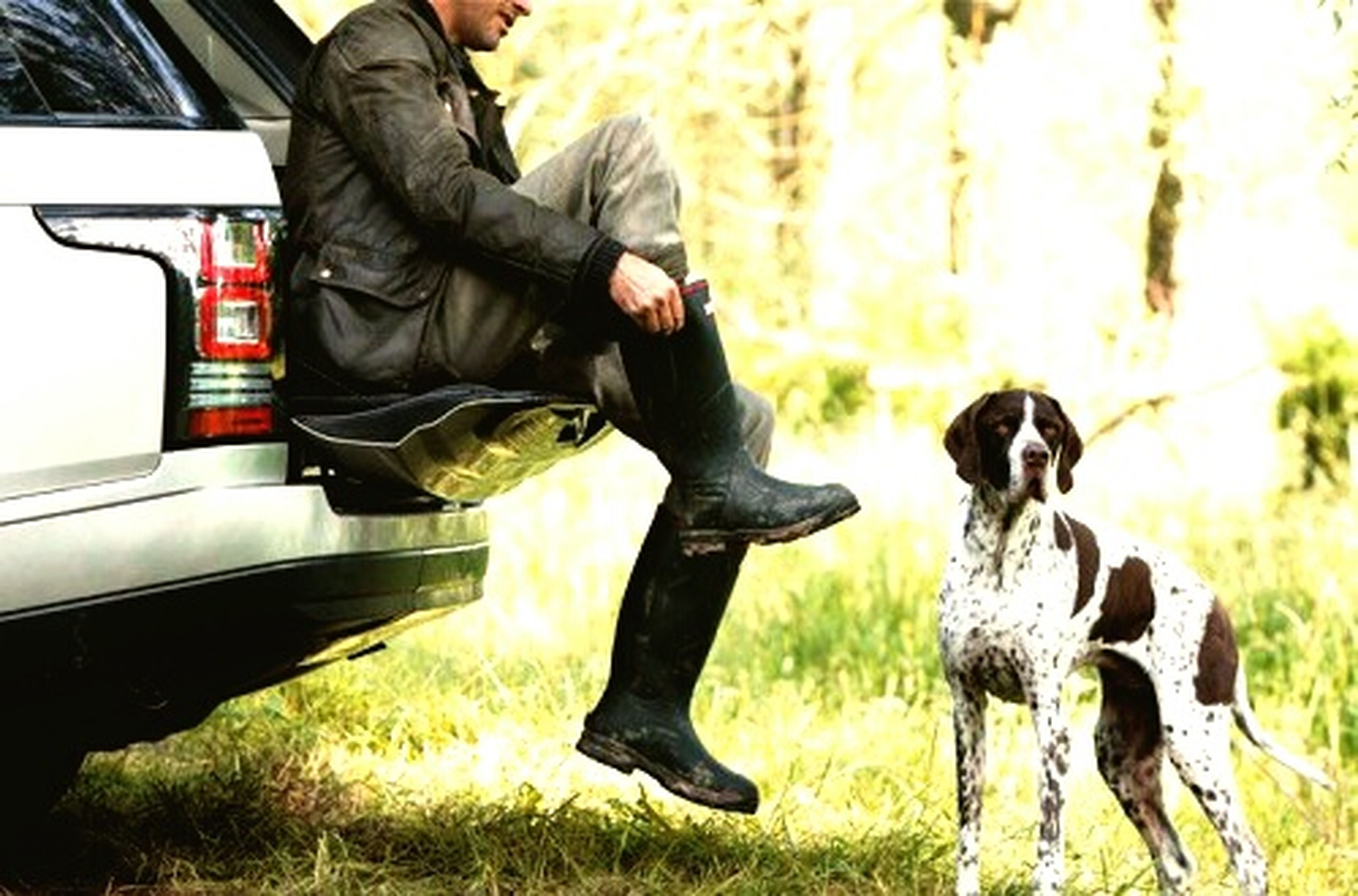 lifestyles, leisure activity, low section, casual clothing, men, holding, standing, focus on foreground, person, land vehicle, side view, car, shoe, sitting, transportation, day