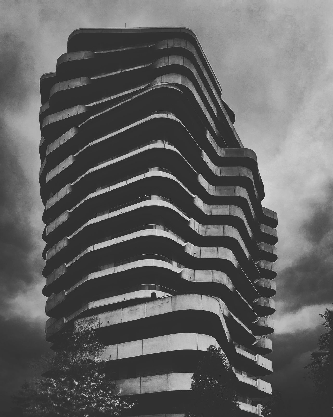 Marco Poli Tower, Hamburg, Germany. Low Angle View Architecture Building Exterior Built Structure Sky Dusk Tall - High Modern Cloud Building Story Office Building Cloud - Sky Repetition Outdoors Tall Treetop Place Of Work Skyscraper Contrasts No People The Architect - 2017 EyeEm Awards