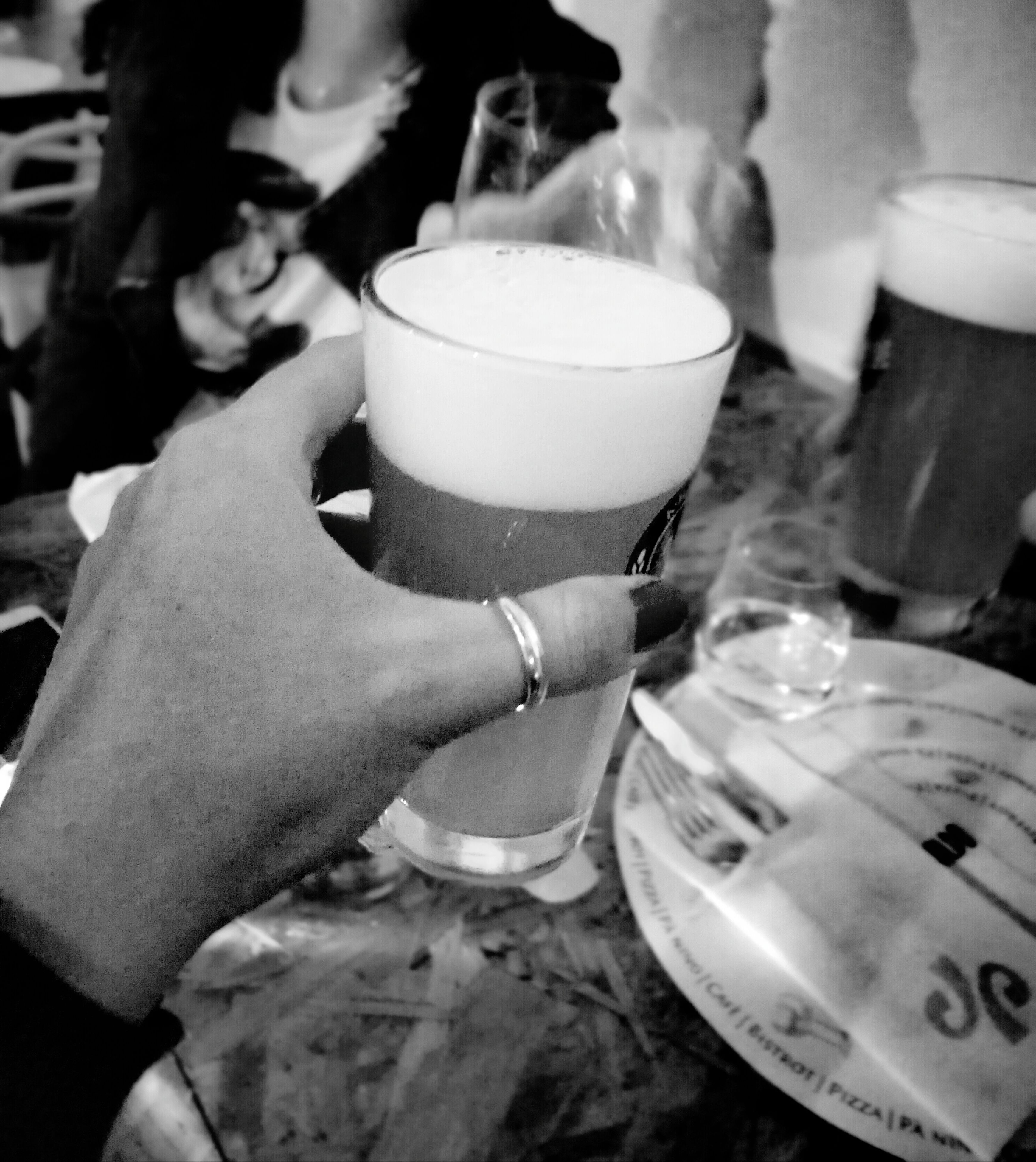 human hand, drink, real people, food and drink, indoors, human body part, drinking glass, refreshment, beer glass, one person, frothy drink, holding, table, beer, men, close-up, alcohol, wristwatch, freshness, day, people