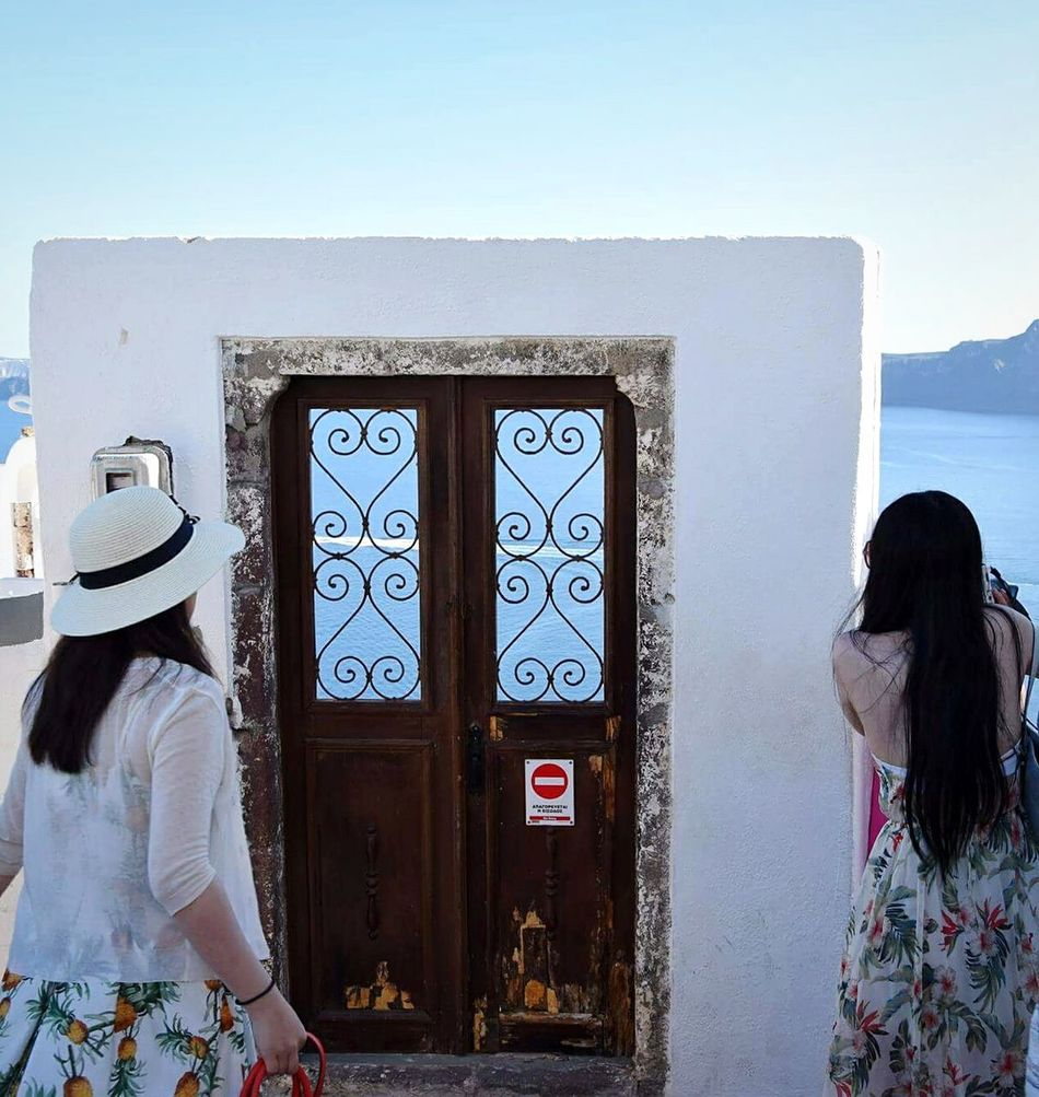 Door of paradise Adults Only Day People Outdoors Women One Woman Only Sky Santorini Island Travel Photography Greece 3XSPUnity Summer EyeEmNewHere Travel Destinations Picsoftheday EyeEm Gallery EyeEm Best Shots Eyeemphotography Hellas Santorini Oia , Thira , Santorini , Greece Sea Door