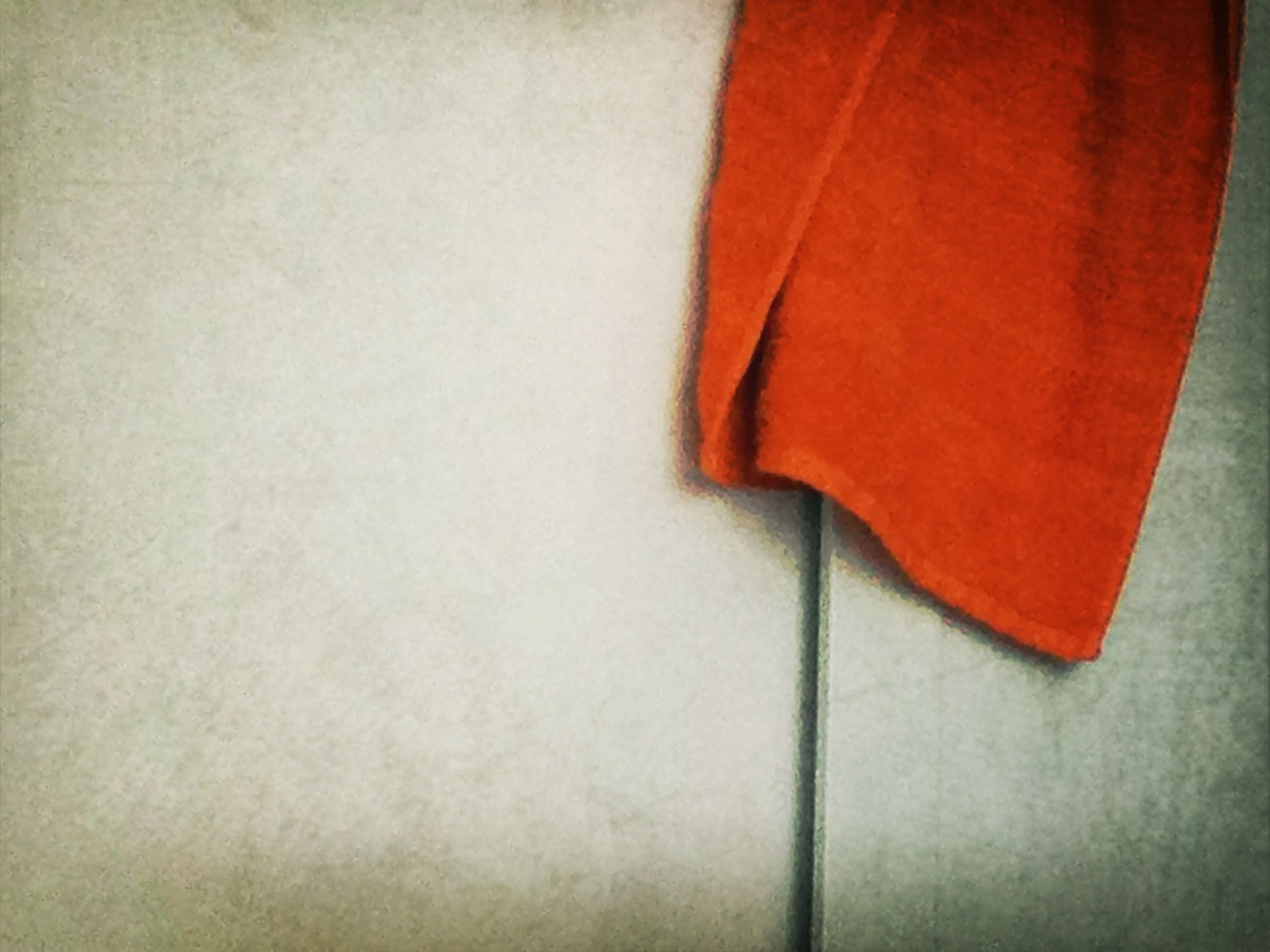 indoors, red, close-up, wall - building feature, white color, orange color, textile, copy space, still life, wall, single object, fabric, textured, part of, no people, pattern, high angle view, simplicity, studio shot, wood - material