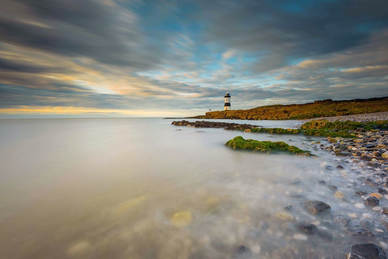 Slow Waves Cloud - Sky Water Lighthouse Built Structure Sea Sky Scenics Building Exterior Nature Tranquility No People Horizon Over Water Outdoors Beauty In Nature Day Sunset The Great Outdoors - 2017 EyeEm Awards Long Exposure Lighthouse_lovers Fishing Seascape Sea Fishing